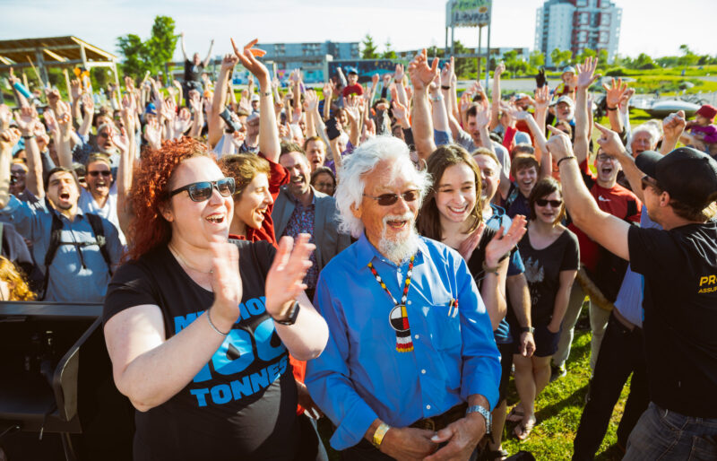 David Suzuki with a crowd of protesters