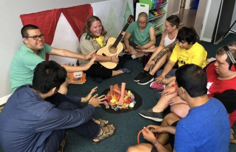 Group sitting around make believe campfire