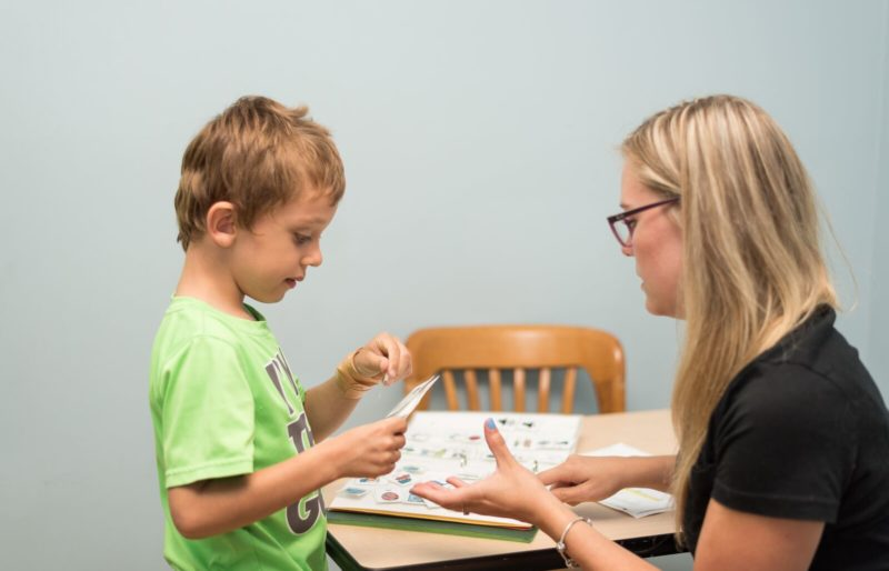 Autism instructor working with child