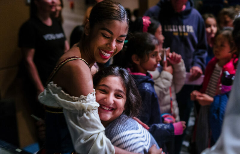 Tene Ward with an Audience Member at a YOU dance performance.