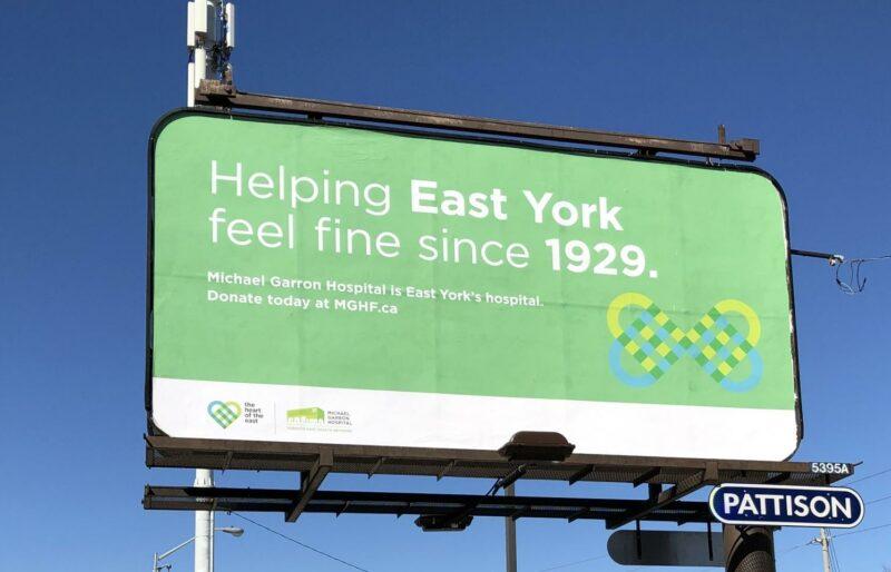 Green billboard that reads