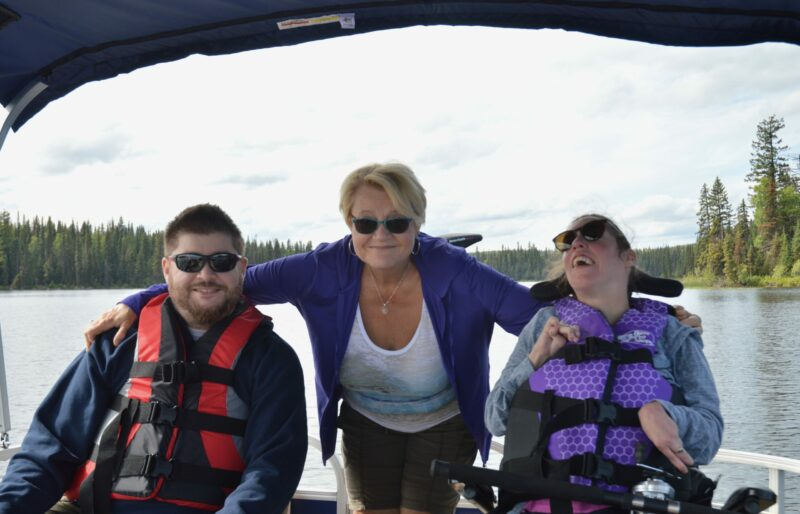 Disabled Woman with her mother and brother on a boat