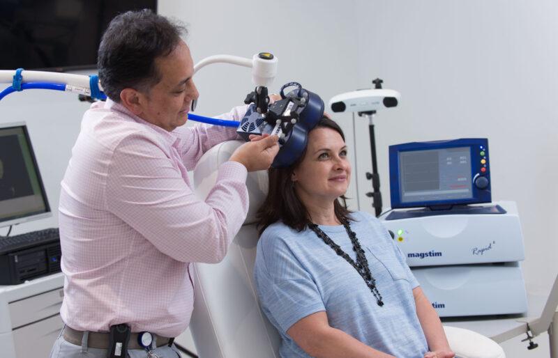 doctor performing procedure on patient with equipment
