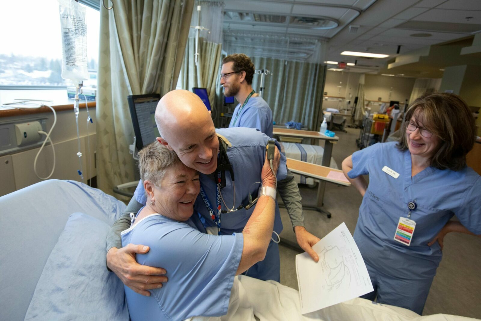 A patient and doctor embrace in a recovery room