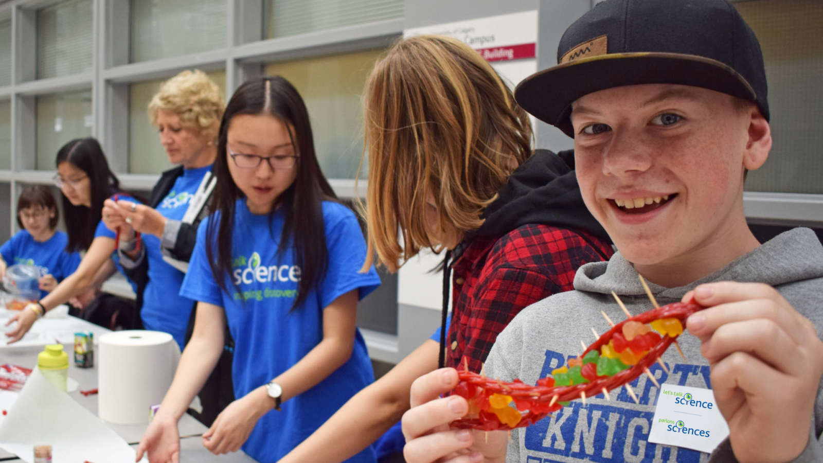 Boy smiling while holding a candy DNA activity