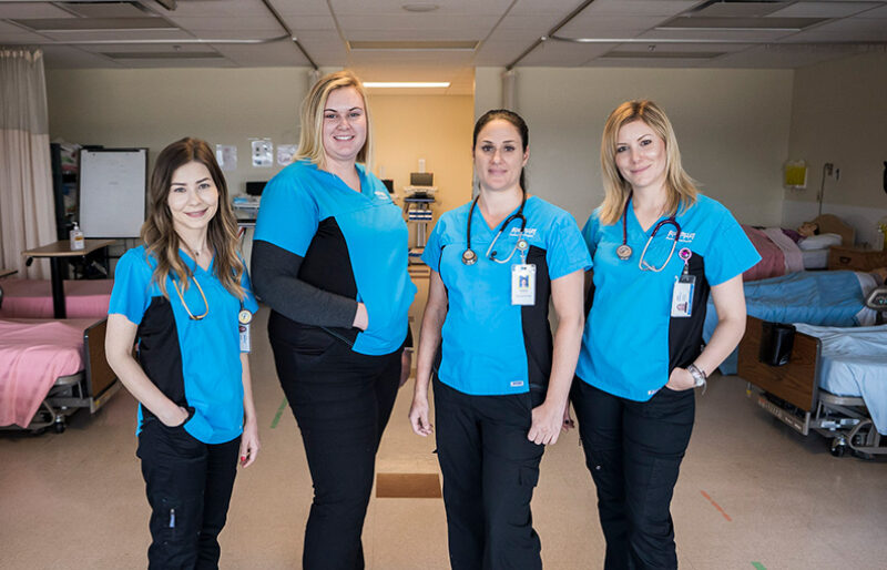 Practical Nurse students pose for picture in one of their classrooms