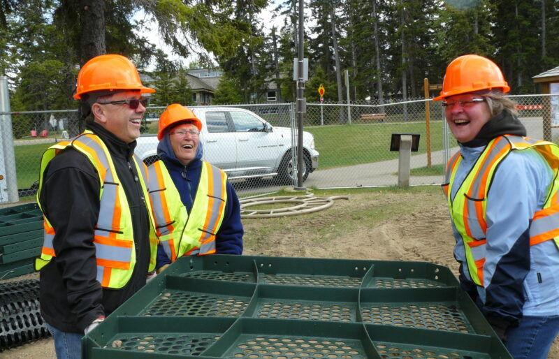 Volunteers work together during construction of the Bears on the Beach Playground at Waskesiu Lake