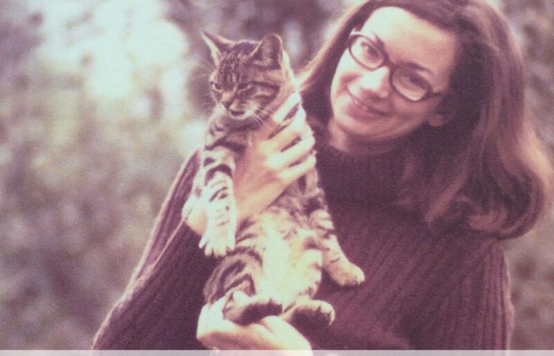 Forever Guardian and animal lover, Marianne, cradles cat Bidule.