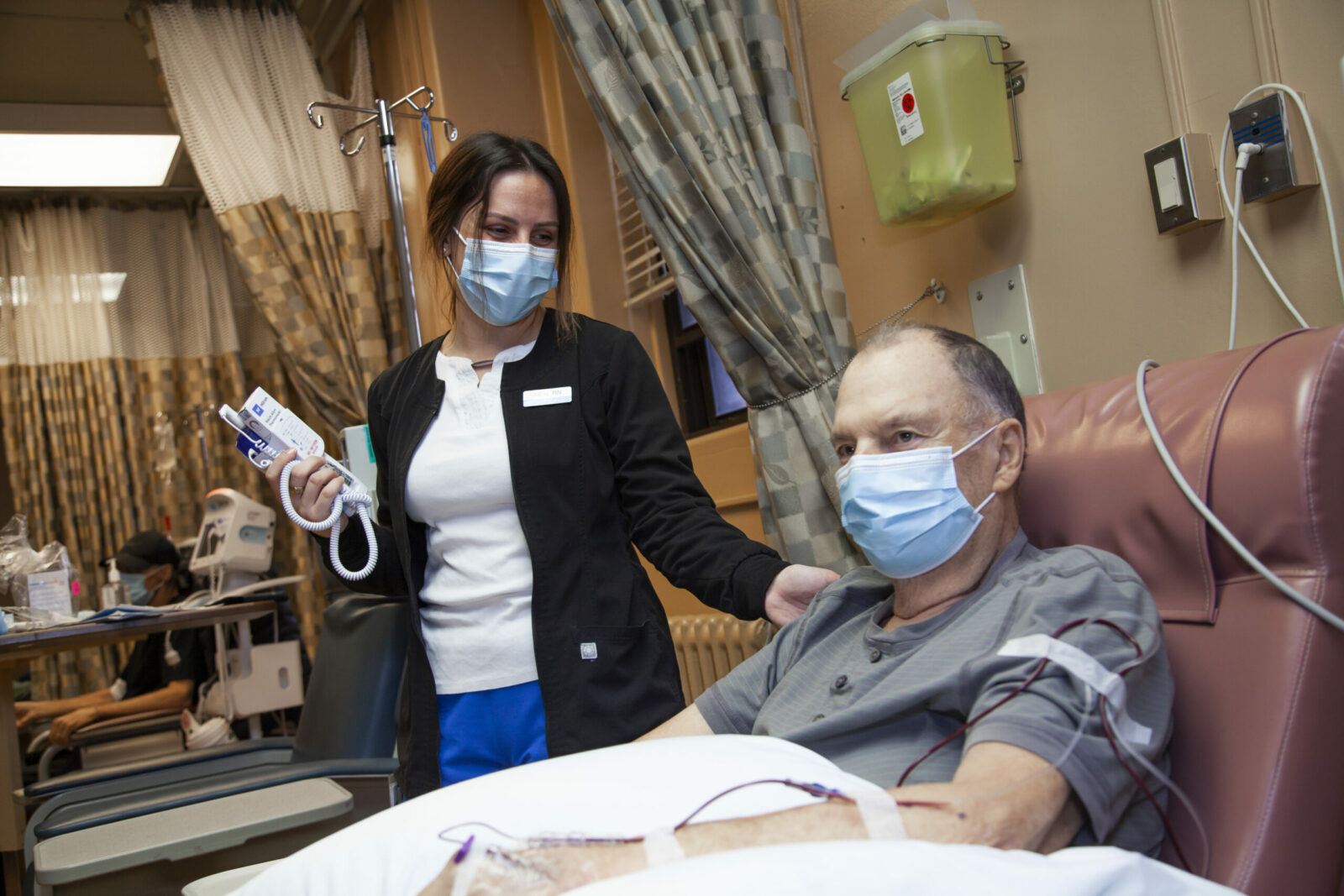 Nurse comforts patient undergoing chemotherapy at the QEII's Medical Day Unit