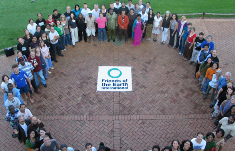 Group photo from Friends of the Earth International meeting, members from 75 country groups standing in a circle.
