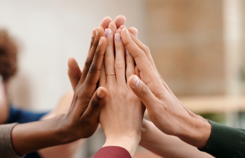 diverse hands coming together